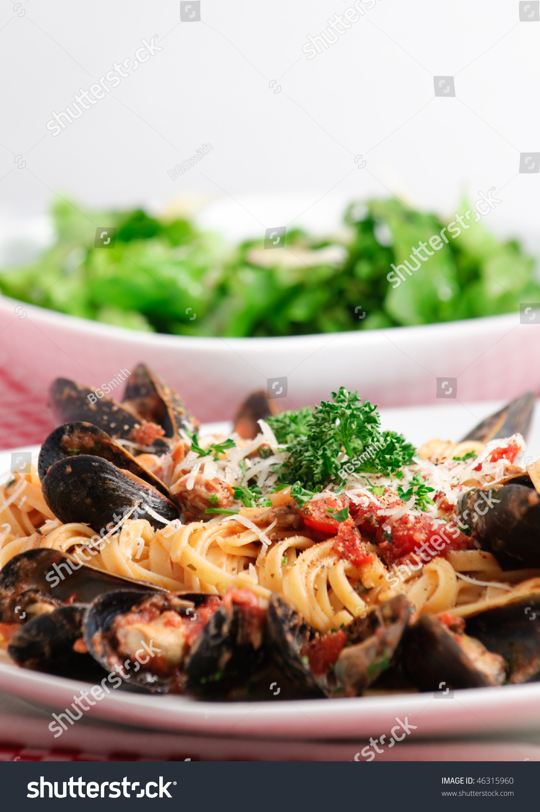 and fresh mussels in tomato sauce with parmesan cheese and fresh herbs ...