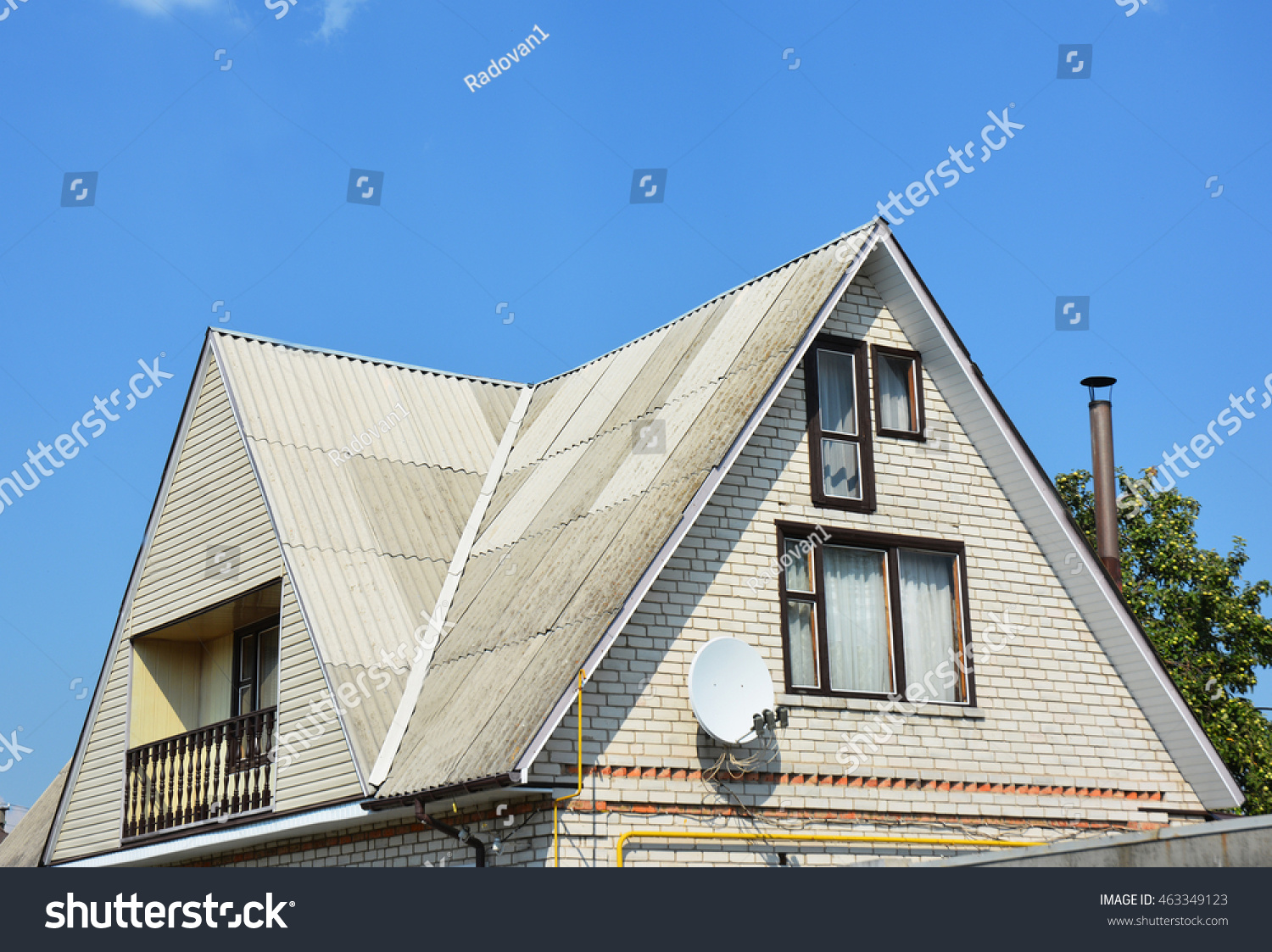 Gable valley type roof construction building stock photo for Brick house construction