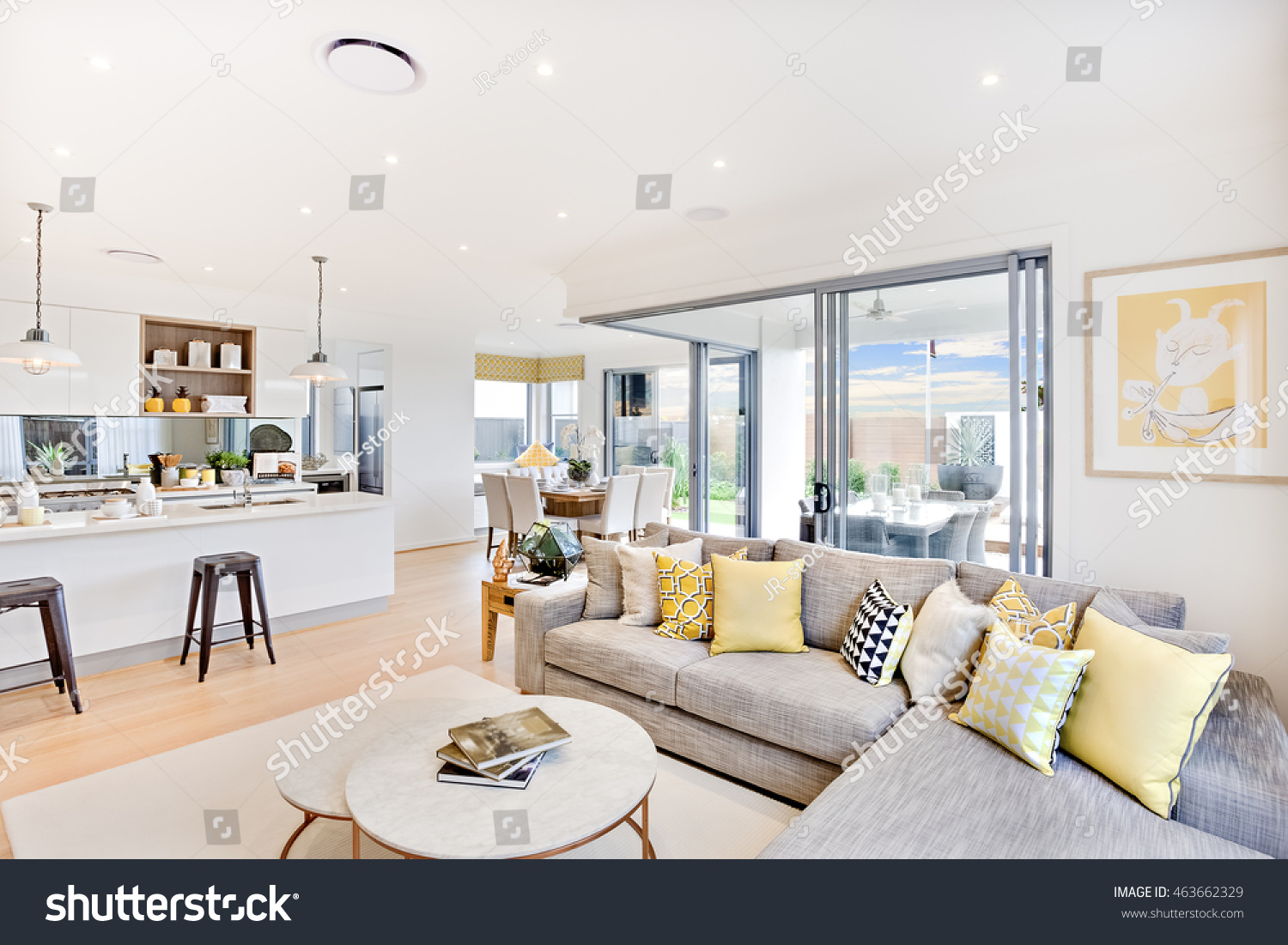 luxury house interior focusing the living room sofa and pillows next round table on the carpet