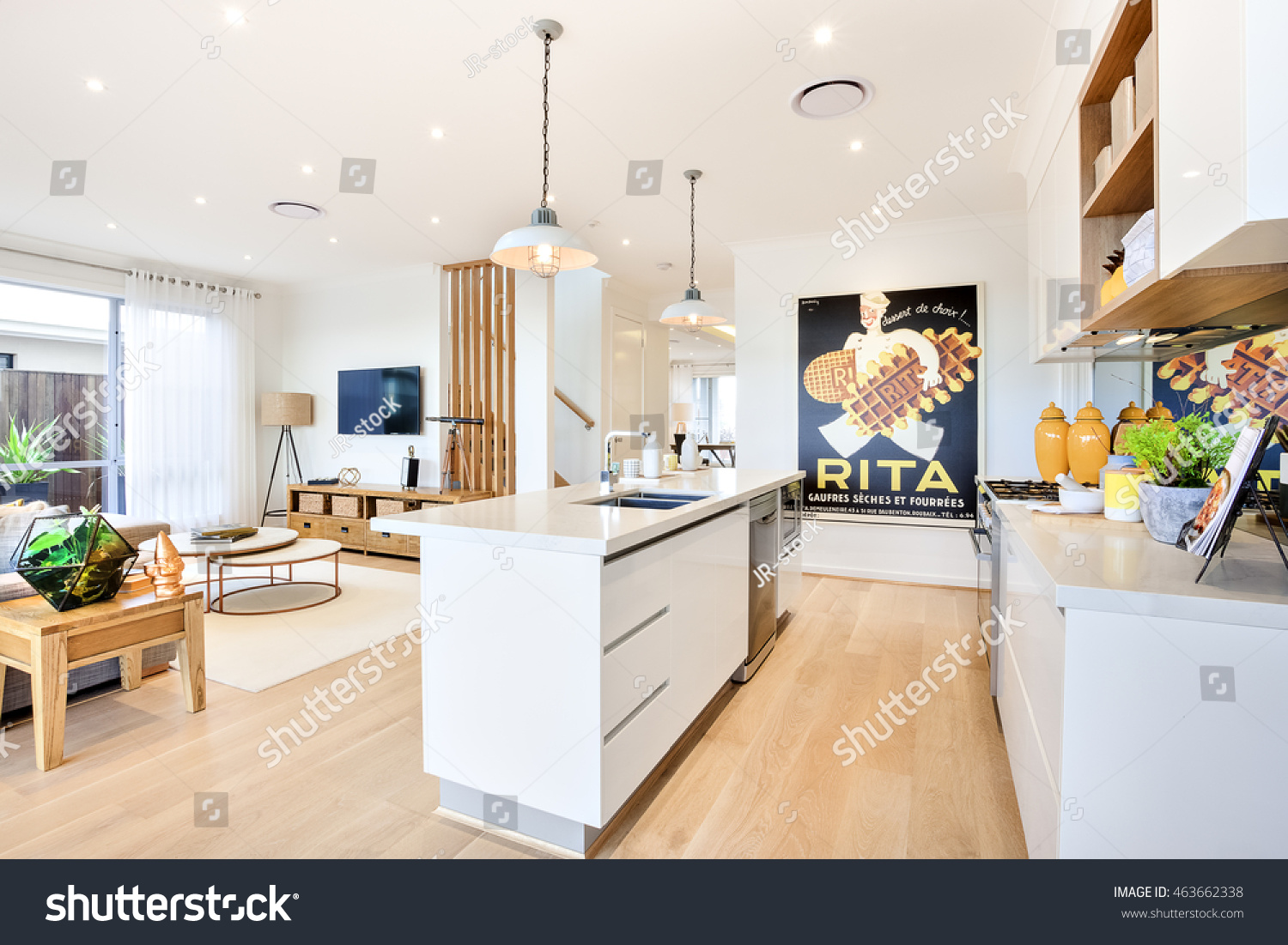 Modern Kitchen With A Wooden Floor Counter Top Beside Pantry Cupboards Fill Utensils