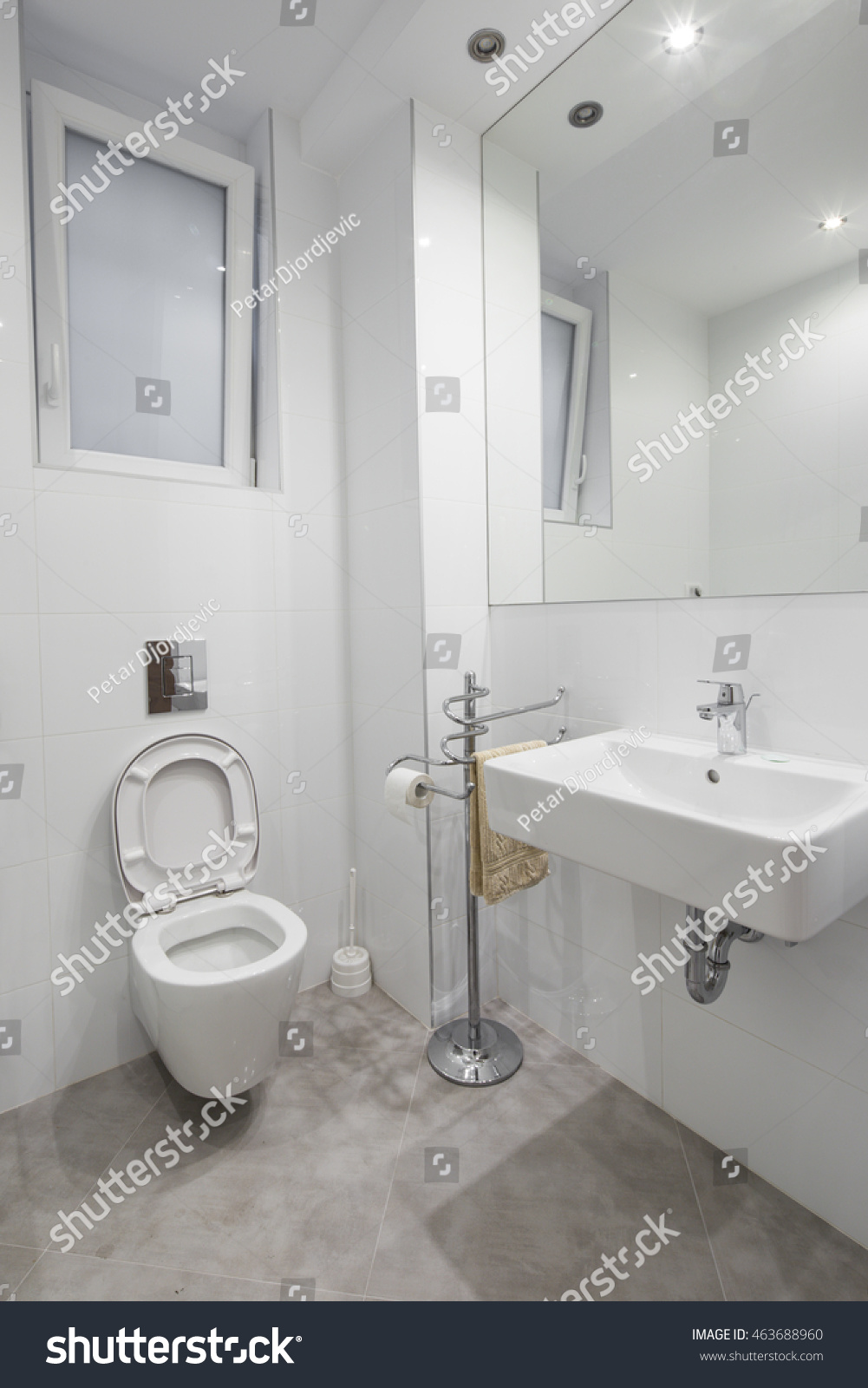 Small Elegant Half Bathroom Stock Photo (Royalty Free) 463688960 ...