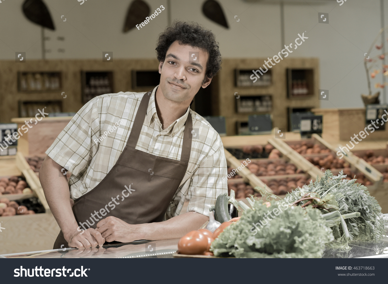 young grocery clerk working produce aisle stock photo