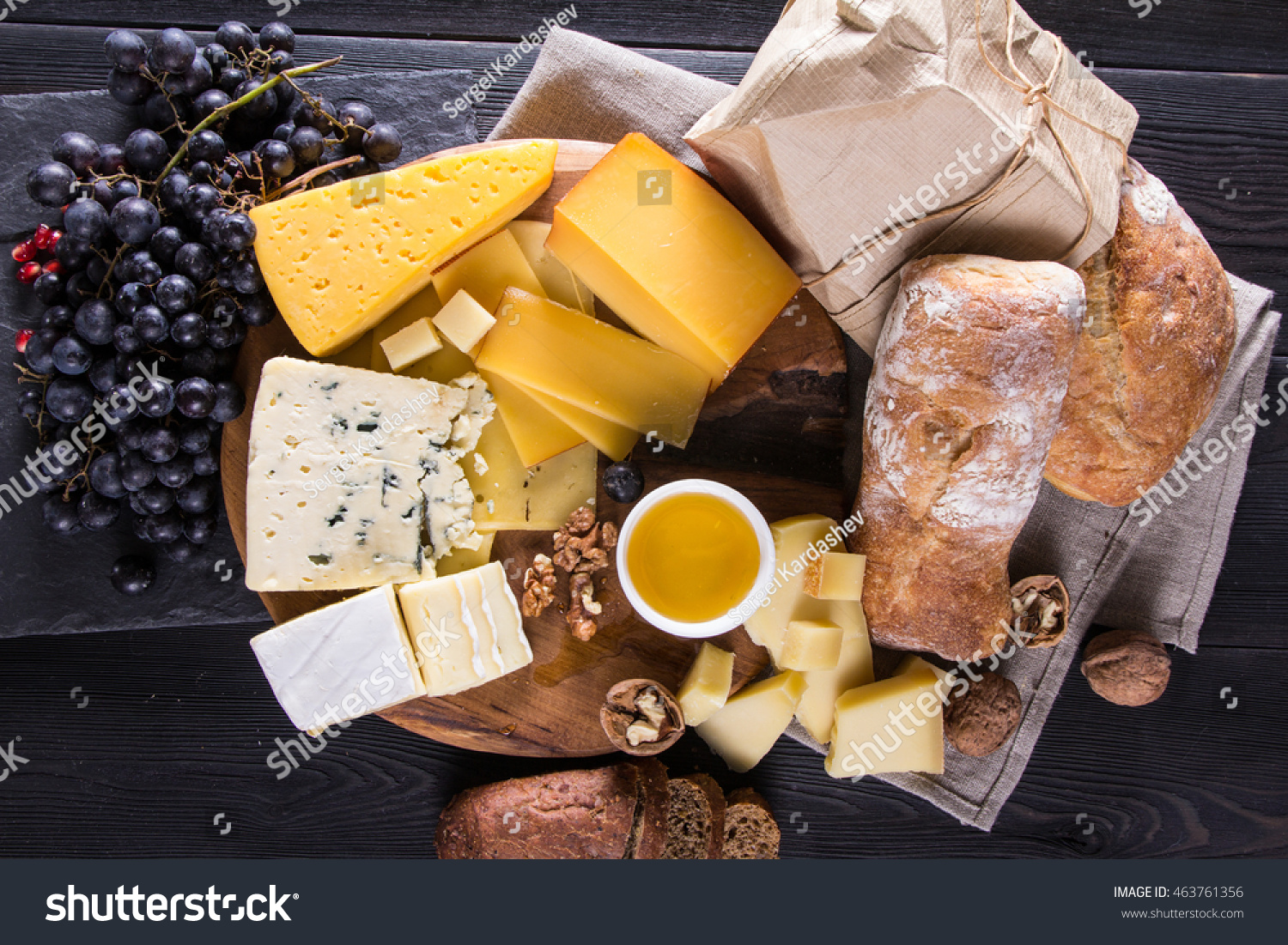 Cheese plate with grapes bread walnut honey and glass of wine. Parmesan & Cheese Plate Grapes Bread Walnut Honey Stock Photo (Download Now ...