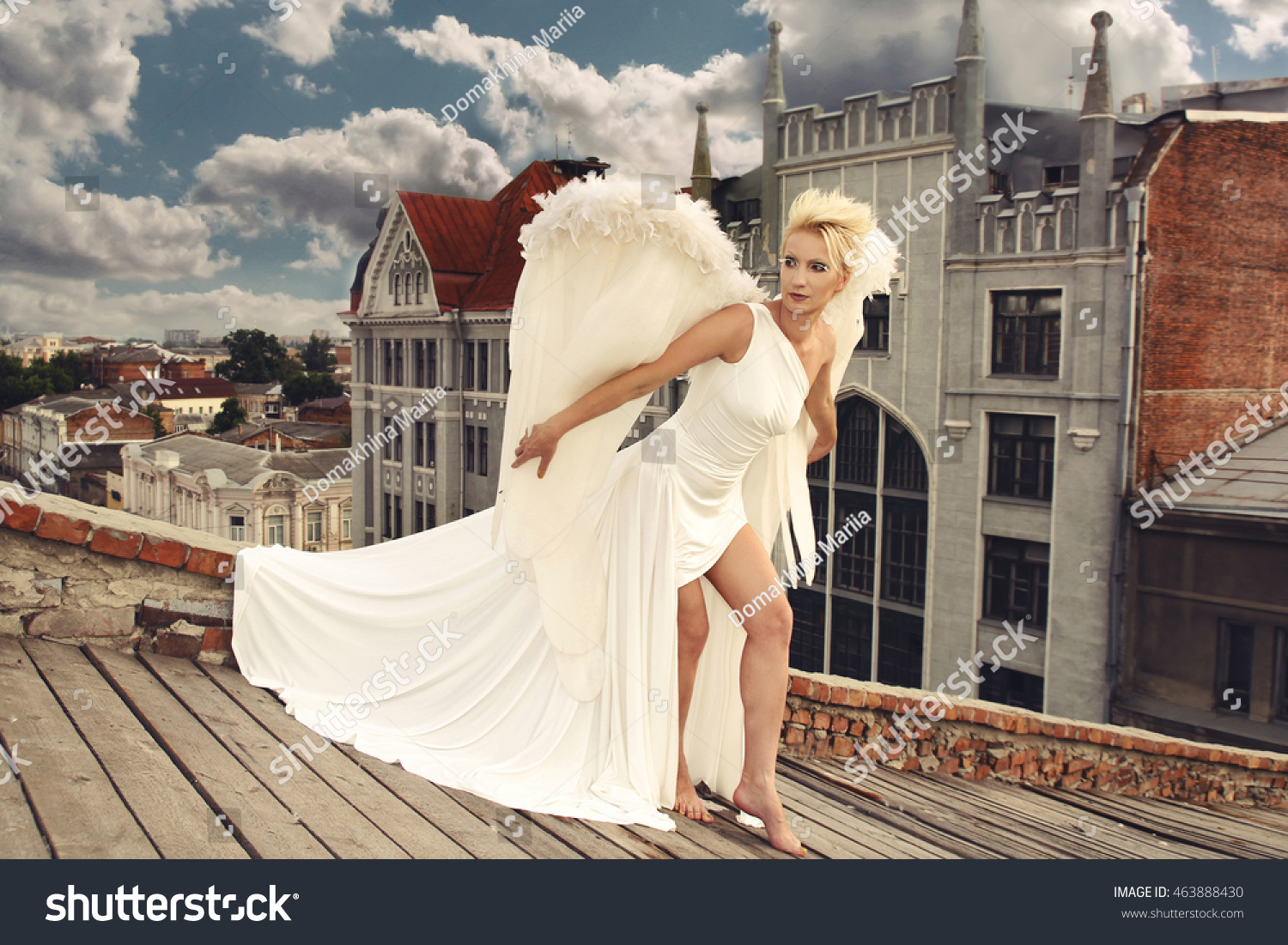 3b6fff91dfa Delicate beautiful blonde woman posing with angel wings. Woman Angel with  Wings. Fashion White