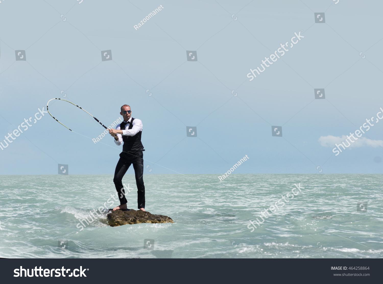 Man suit on desert island fishing stock photo 464258864 for Desert island fishing