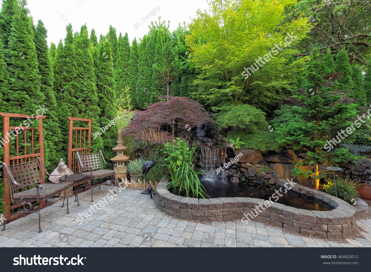 backyard garden landscaping waterfall pond trees stock photo