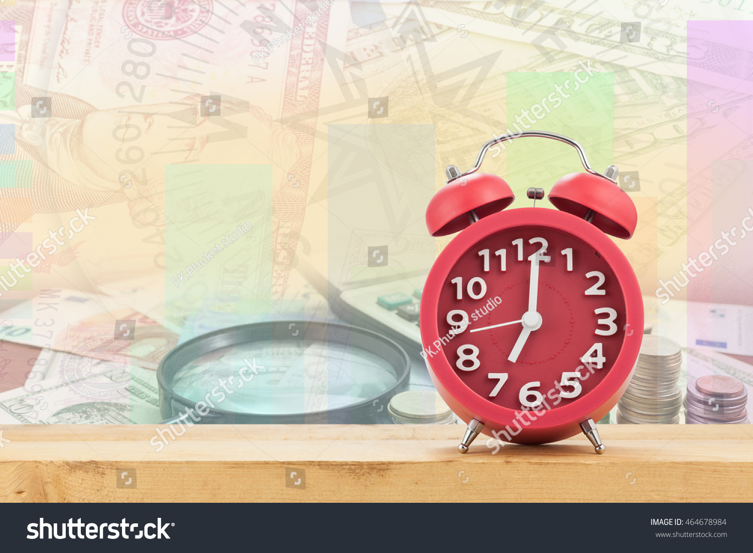 Red old fashioned alarm clock on Calculator with coin and Magnifying glass on money banknotes  #464678984