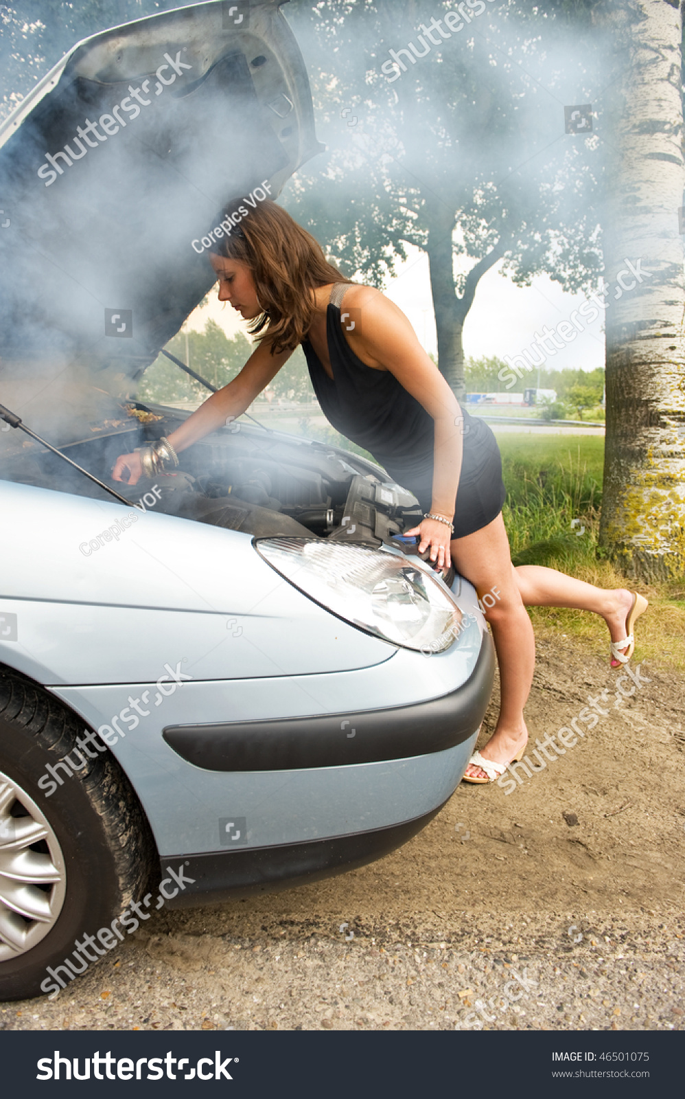 Young Woman Bending Over Blown Engine Stock Photo 46501075 -7489