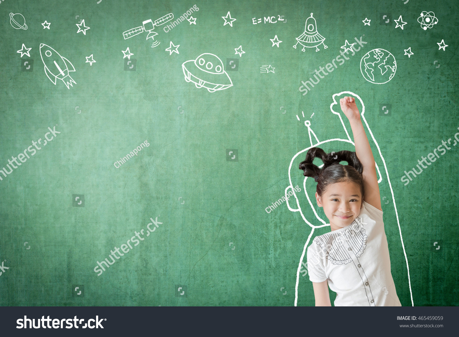 Happy little asian girl kid in astronaut suit doodle drawing+ universe space out of earth planet on school green class chalkboard chalk board background Creative innovation educational conceptual idea