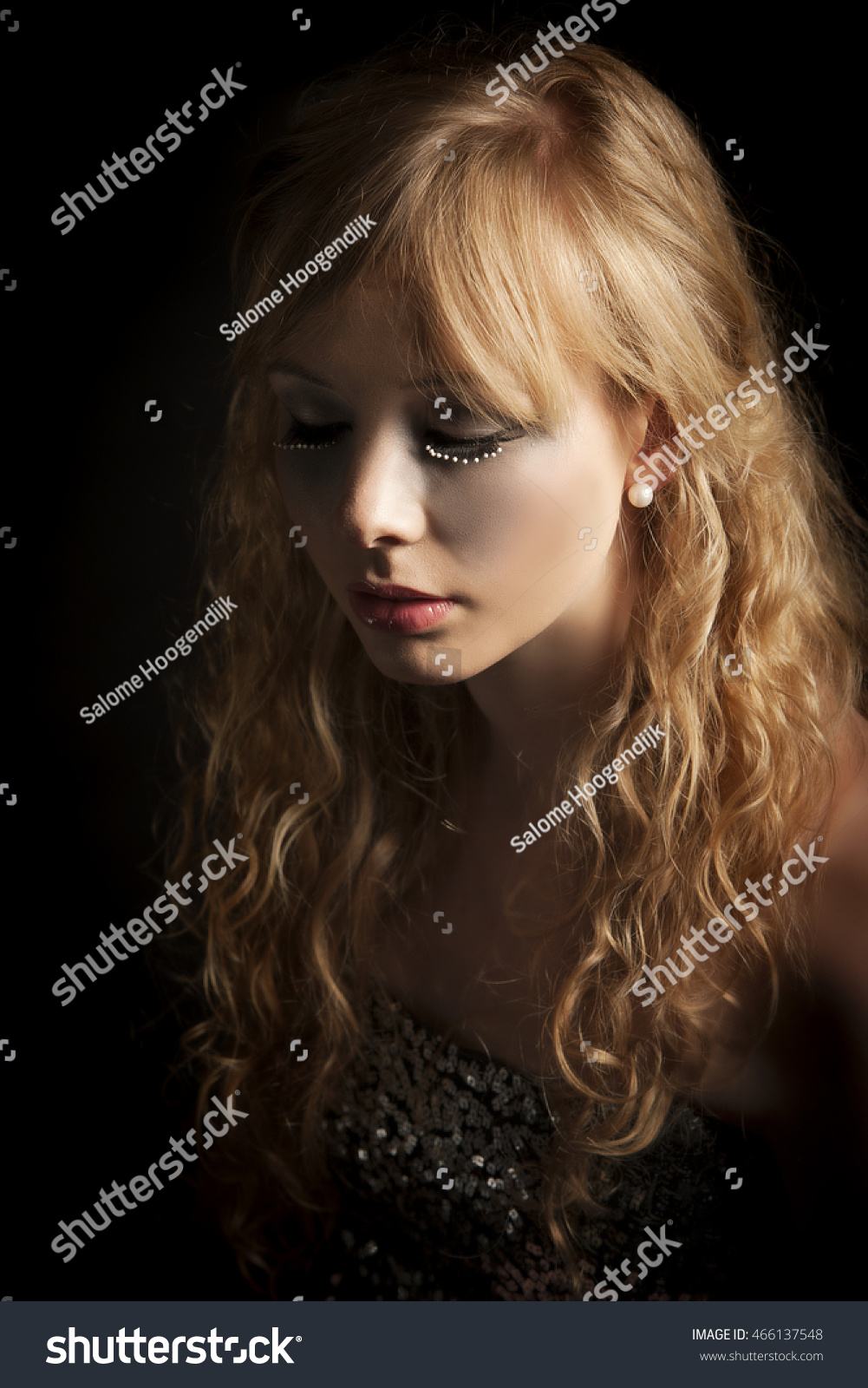 f31207aee8b Portrait of beautiful blonde woman wearing fantasy makeup of silver  eyeshadow