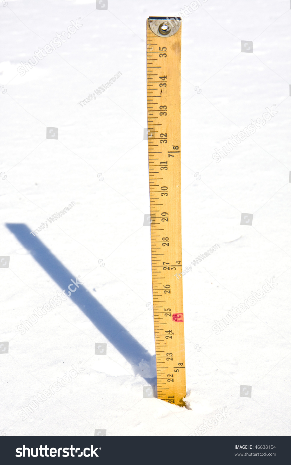Yardstick Measuring The Depth Of Snow And Shadow Behind It ...