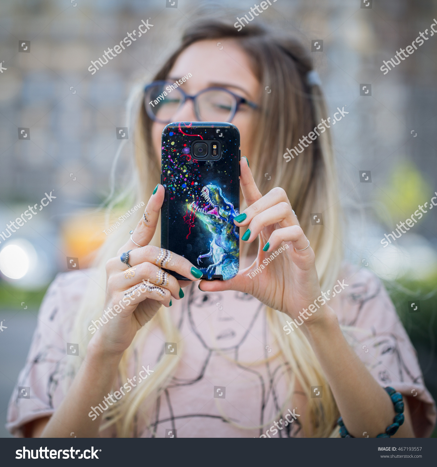 Young blond girl taking a selfie with a phone Custom artwork print on case Blurred background