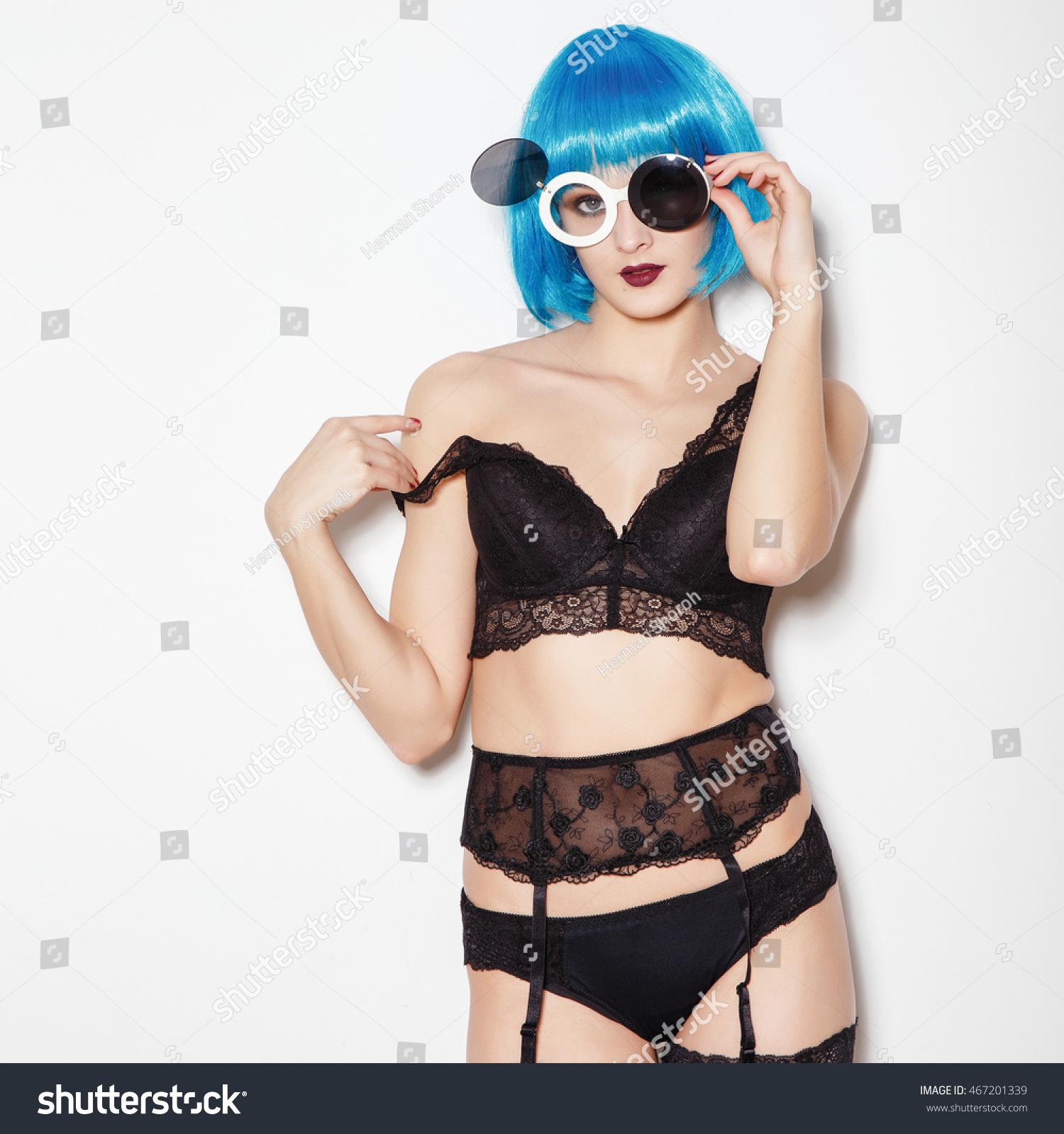210ac0b8e8 ... glamor stylish steam punk young woman model with perfect sunbathed body  with red lips crazy eyeglasses in the black underwear sign on white  background