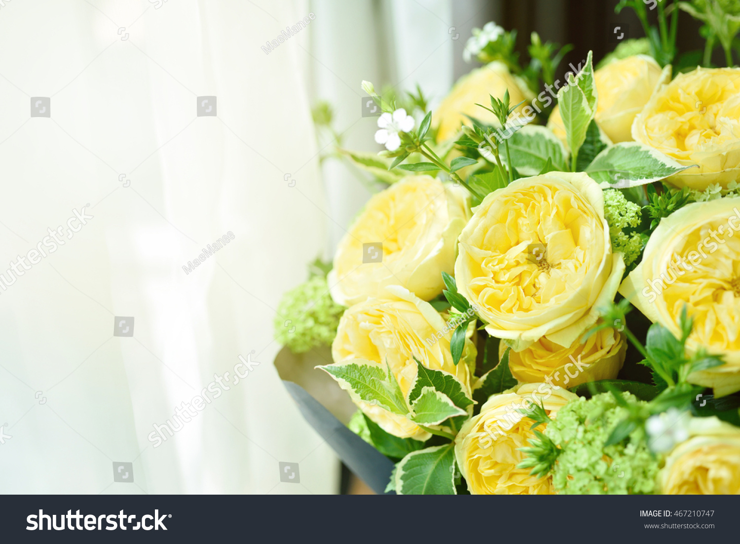Beautiful yellow english roses flower bouquet stock photo royalty beautiful yellow english roses flower bouquet on wooden table next to window with sun light izmirmasajfo
