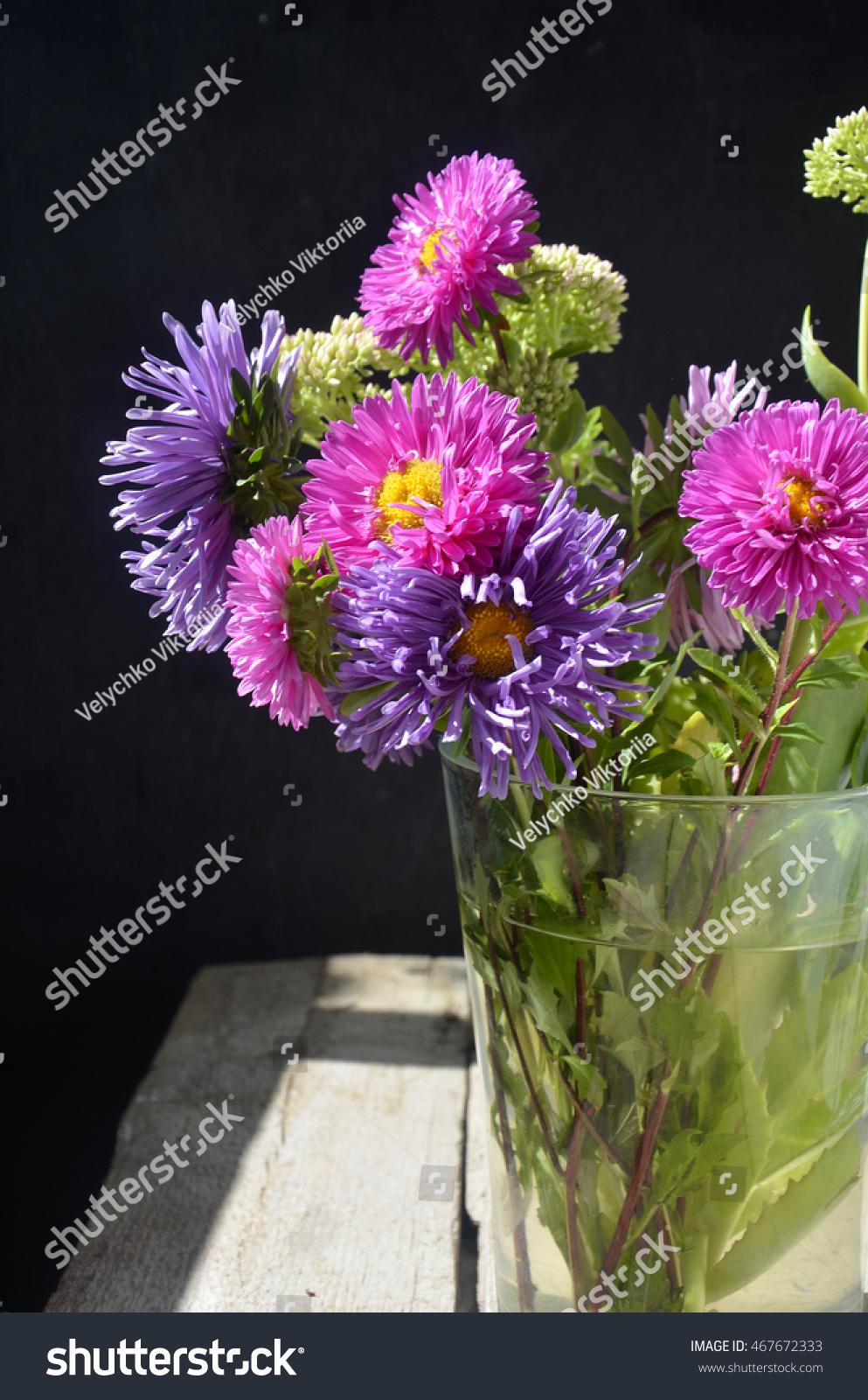 Beautiful aster flower bouquet on wooden stock photo edit now beautiful aster flower bouquet on wooden table izmirmasajfo