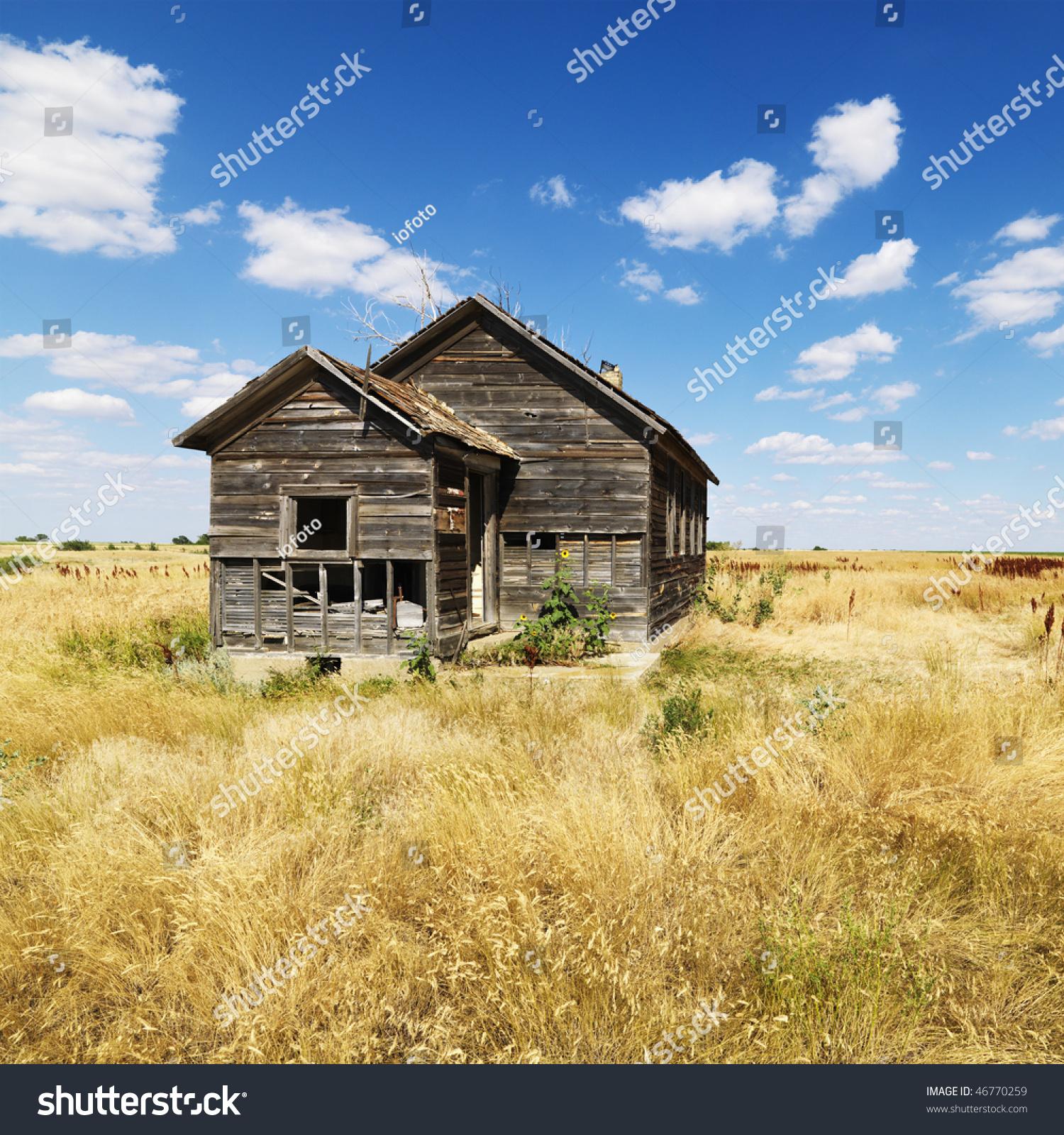 Abandoned House In State Of Disrepair In Field In Rural