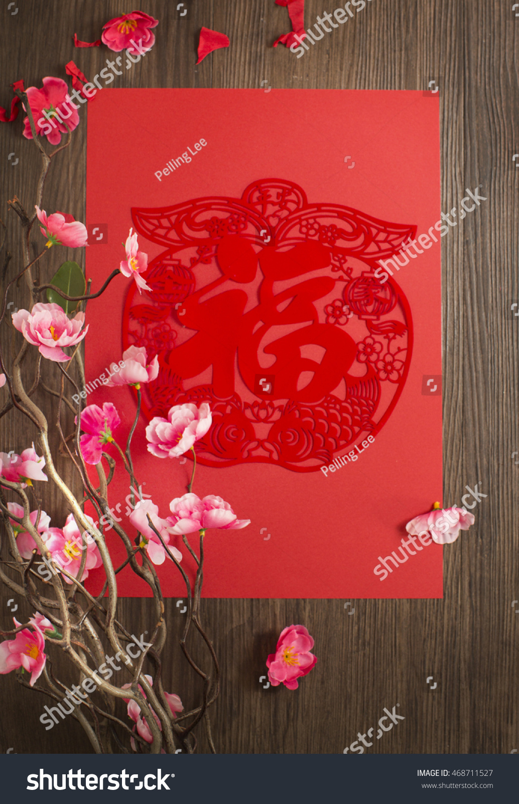 Flat Lay Chinese New Year Red Paper Cutting Wall Decoration And Plum Blossom On Wooden