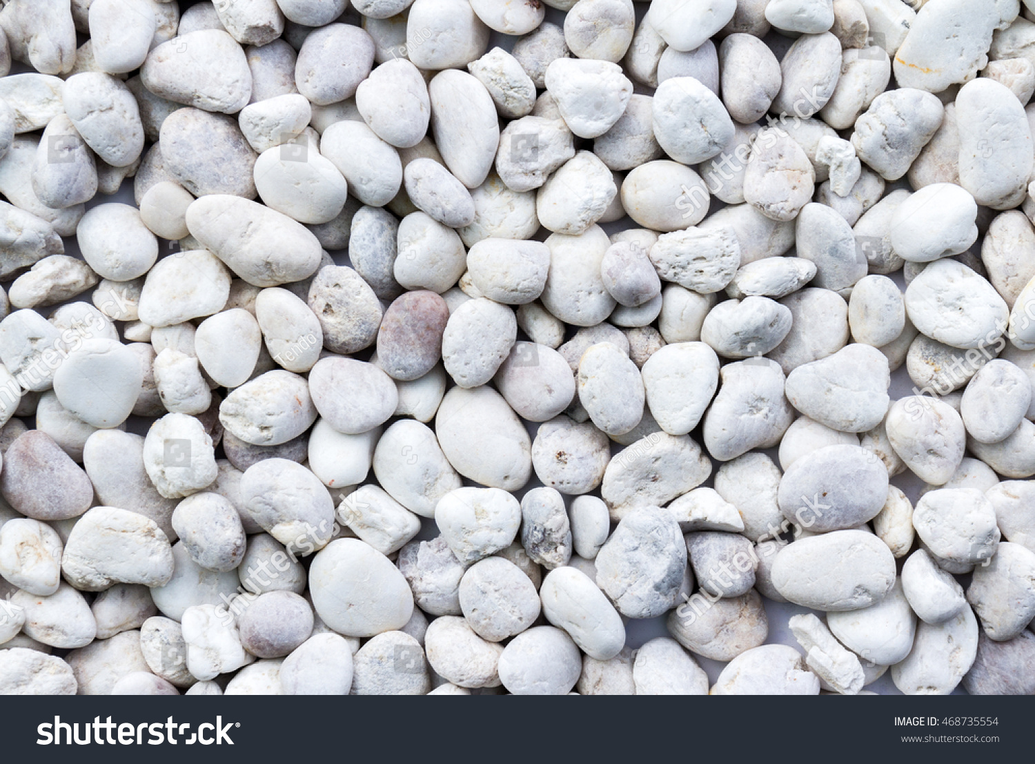 Smooth shaped white stones surface texture background stock photo - White Pebbles Stone Texture And Background