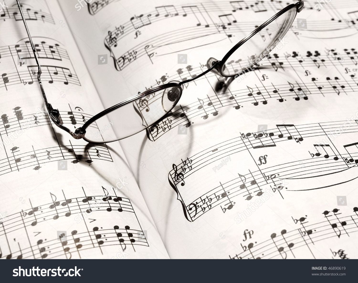 Eyeglass casts heart shadow on music stock photo royalty free eyeglass casts heart shadow on music stock photo royalty free 46890619 shutterstock ccuart Image collections