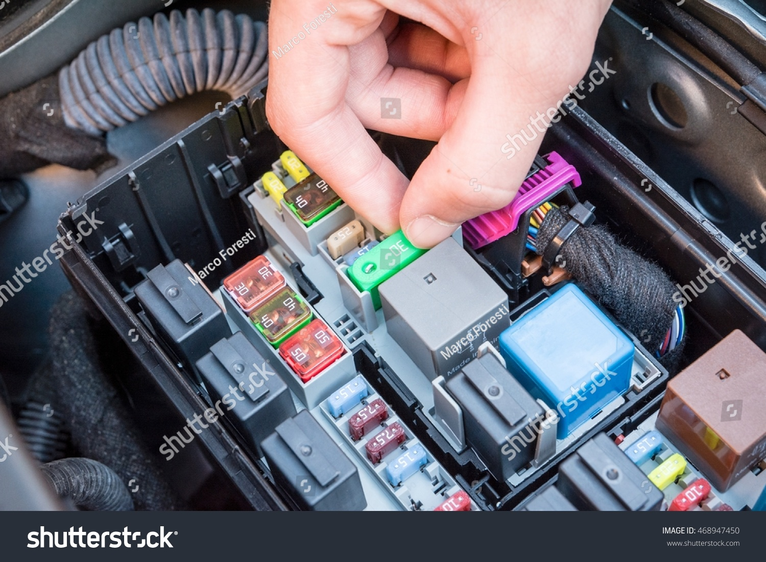 Hand Checking Fuse Box Modern Stock Photo Edit Now 468947450 Car Purpose A In The Of Engine