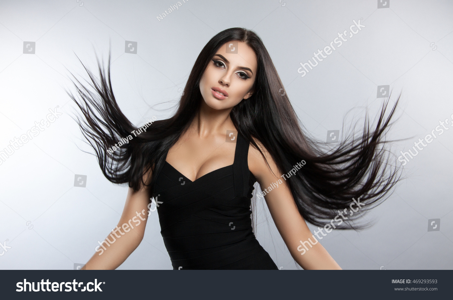 Black dress hairstyle - Beautiful Model With Smooth Flying Hair Fashion Portrait Of A Brunette Woman In A Black