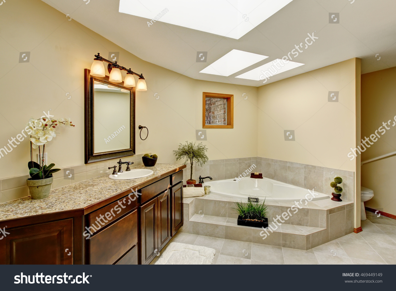 Modern bathroom with vanity cabinet with granite counter top and ...