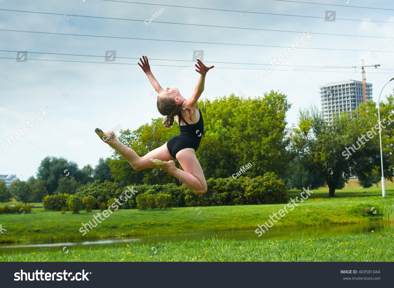 preteen stretch Young beautiful preteen girl doing gymnastic stretch jumps yoga outdoors in park