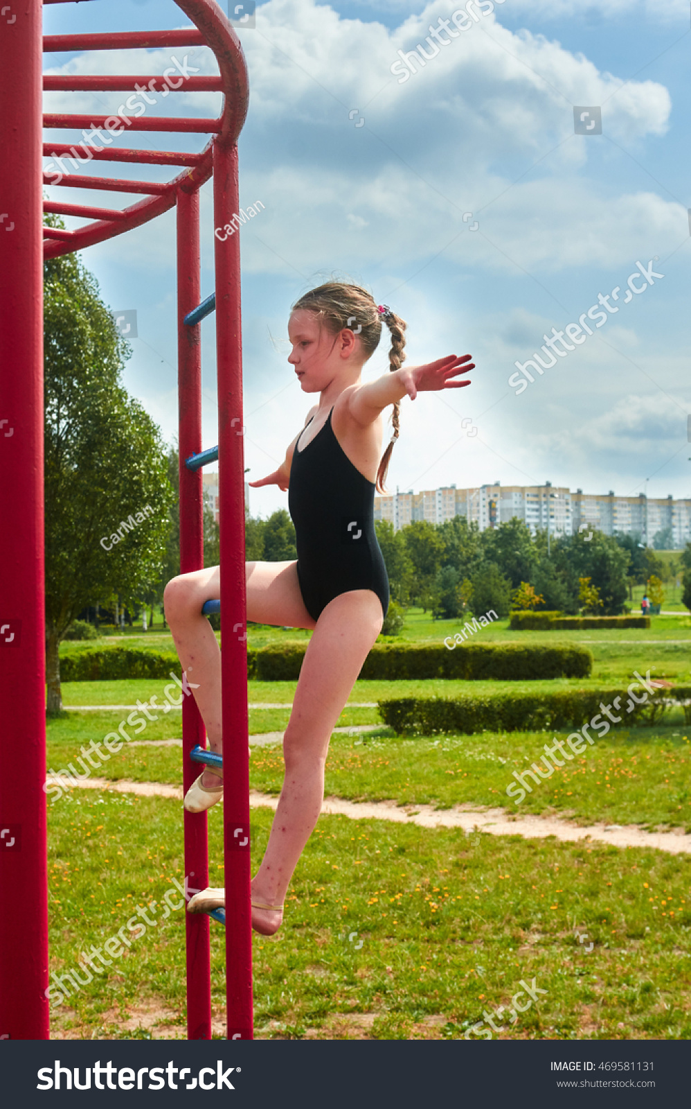 preteen stretch Young beautiful preteen girl doing gymnastic stretch yoga outdoors in park
