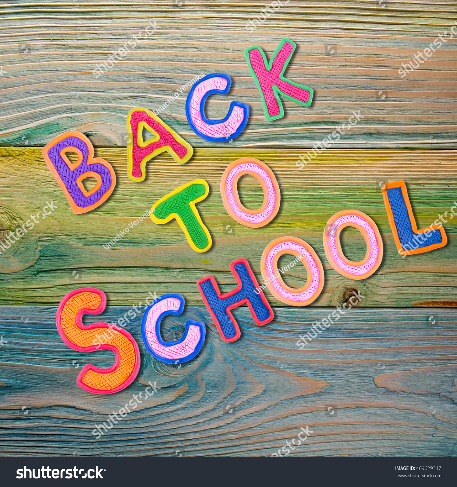 Back To School Desk Table Top View, Words On Grunge Old Wooden Board  Background.