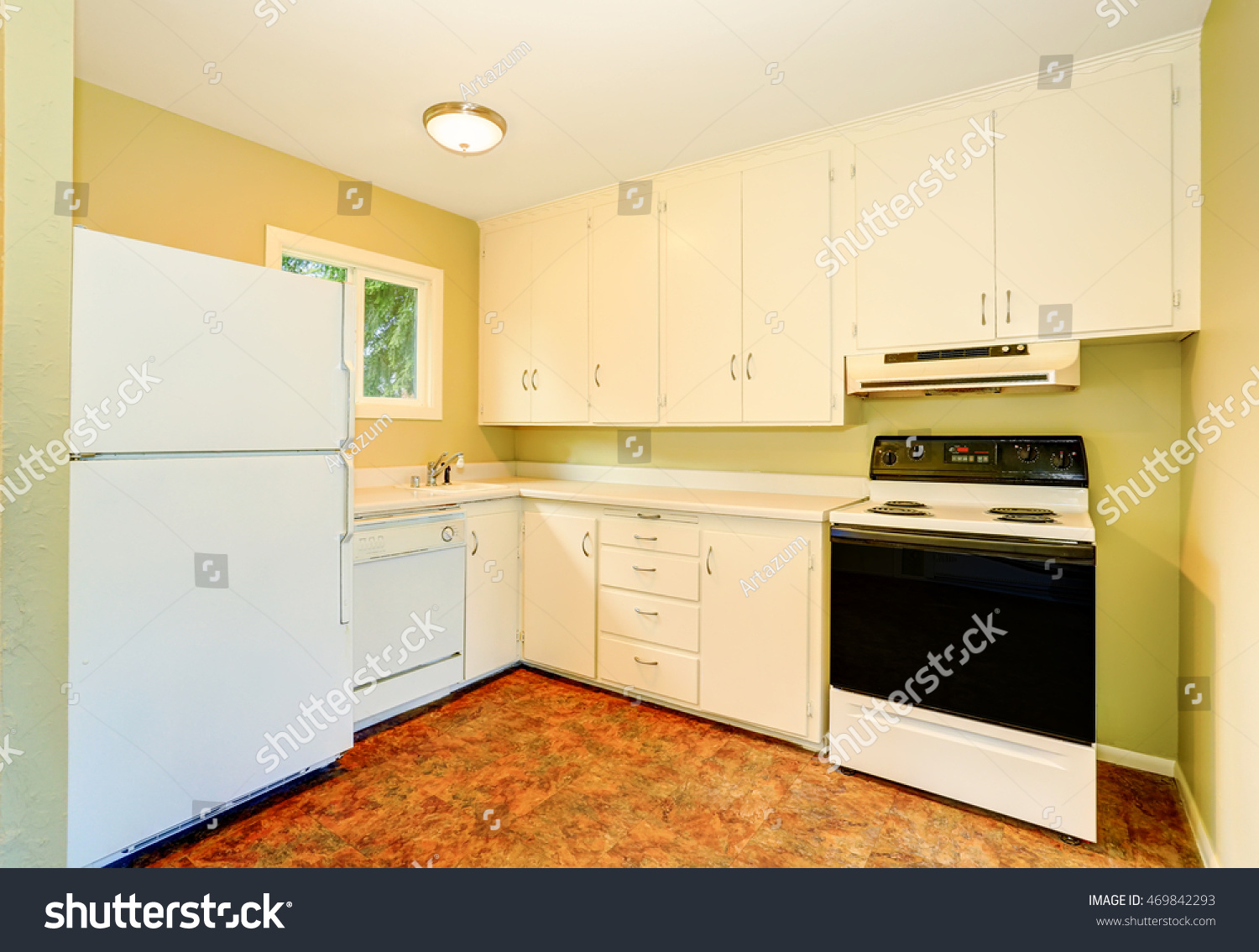 Old Style Simple Kitchen Interior With Cabinets And White Appliances.  Northwest, USA