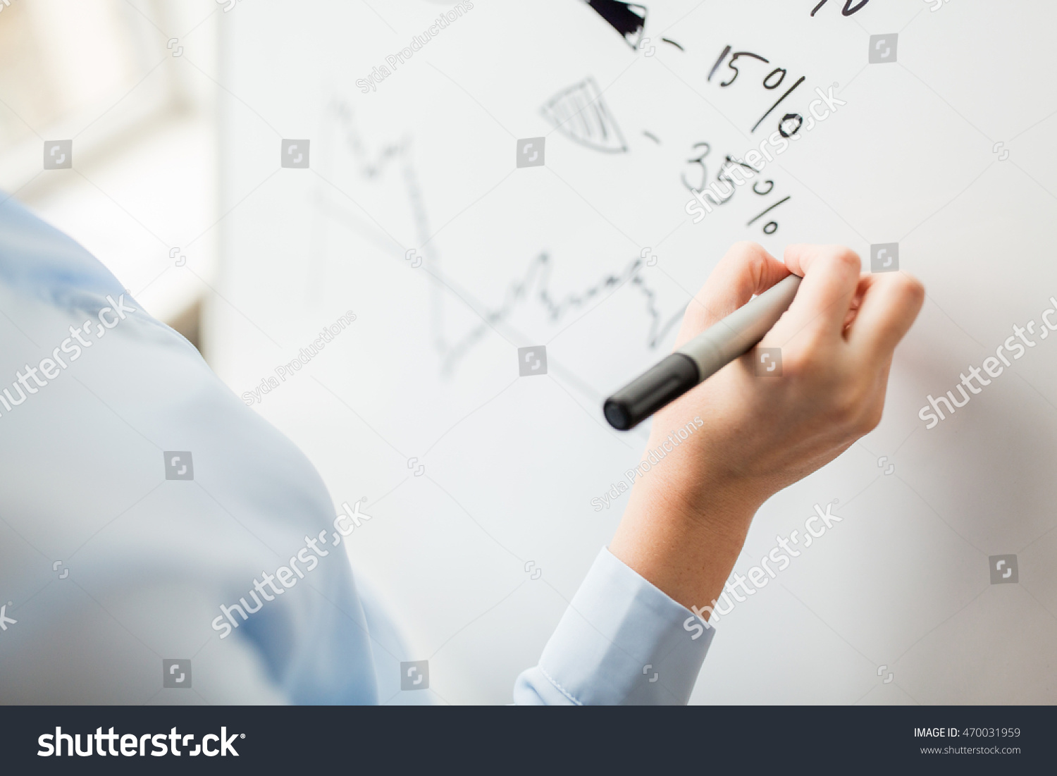 business people economics analytics and statistics concept close up of hand with marker drawing graph on office white board