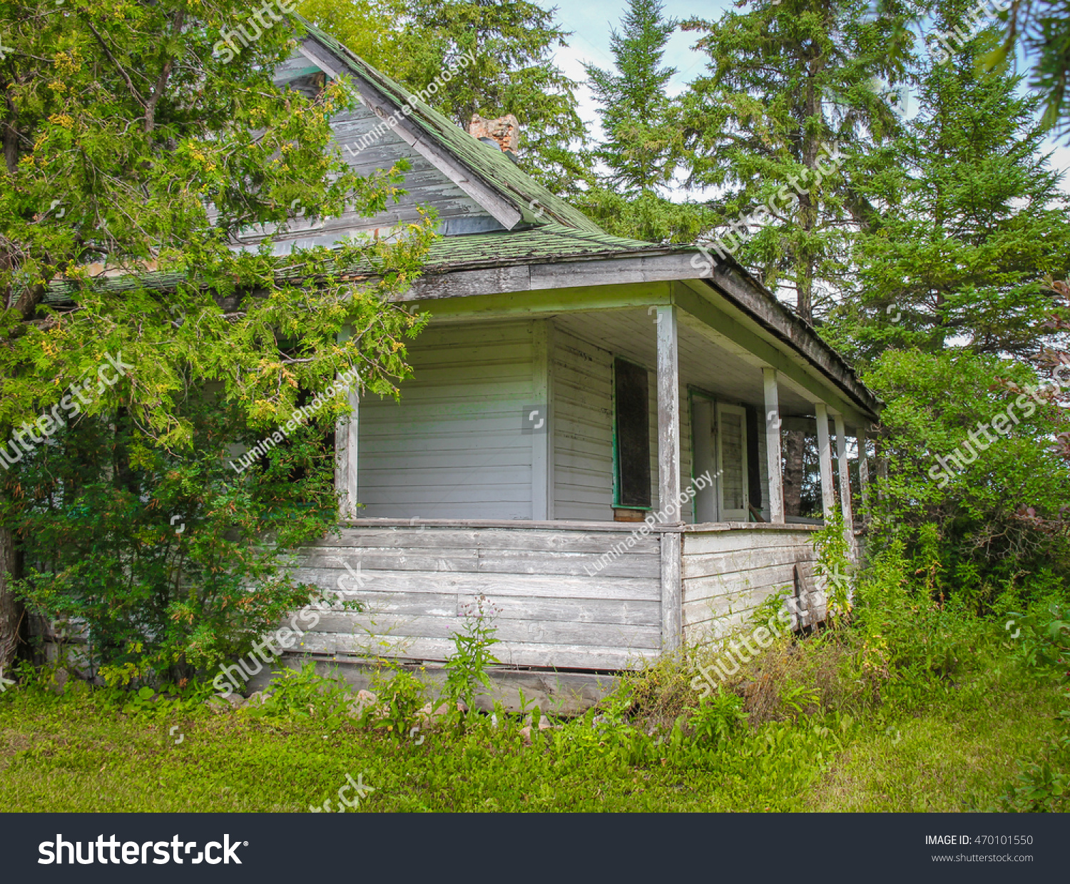 Great Old House With Veranda On Abandoned Farm In Manitoba Canada