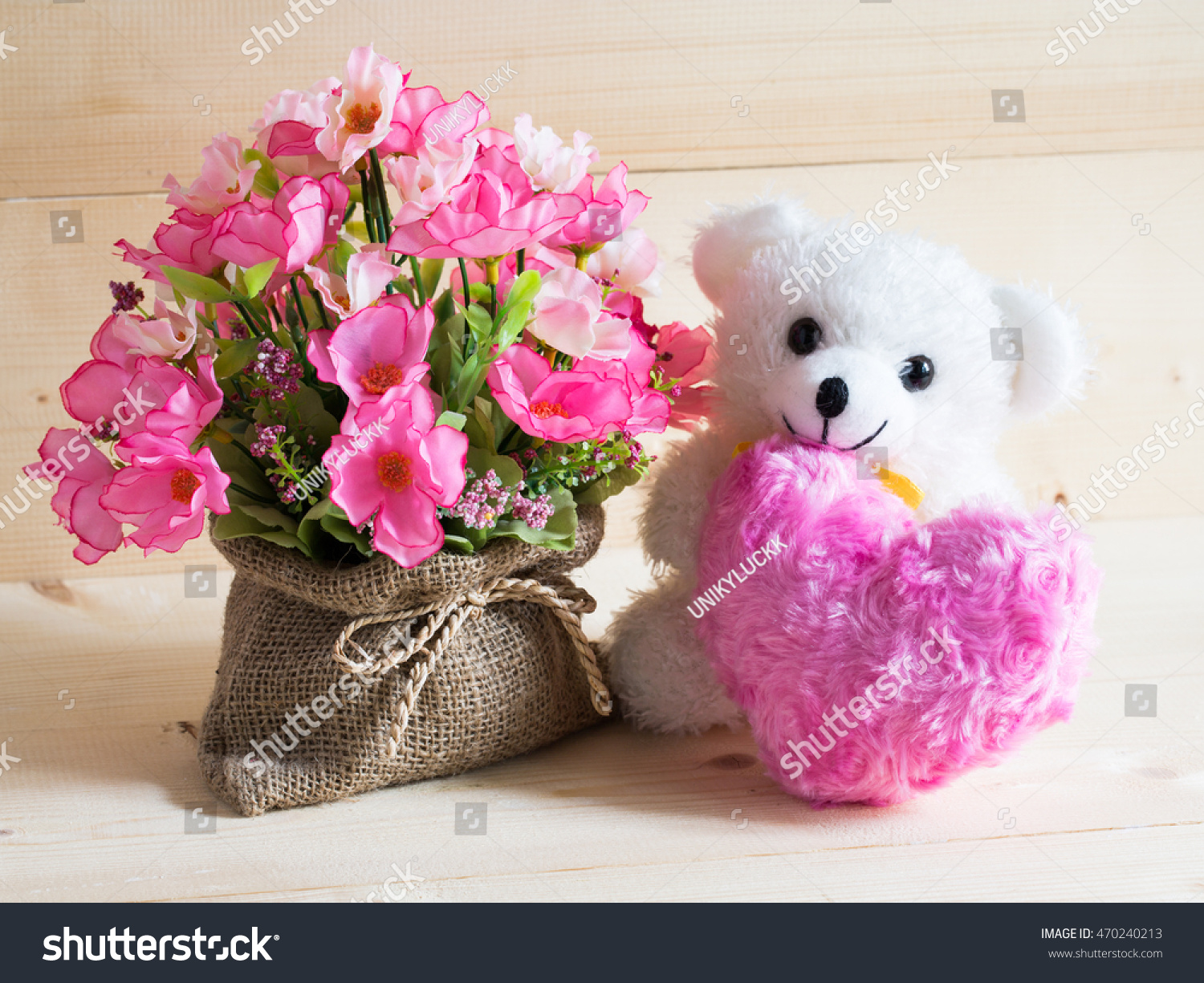 Beautiful flowers box teddy bear pink stock photo edit now beautiful flowers in the box and a teddy bear and pink heart on wooden background izmirmasajfo