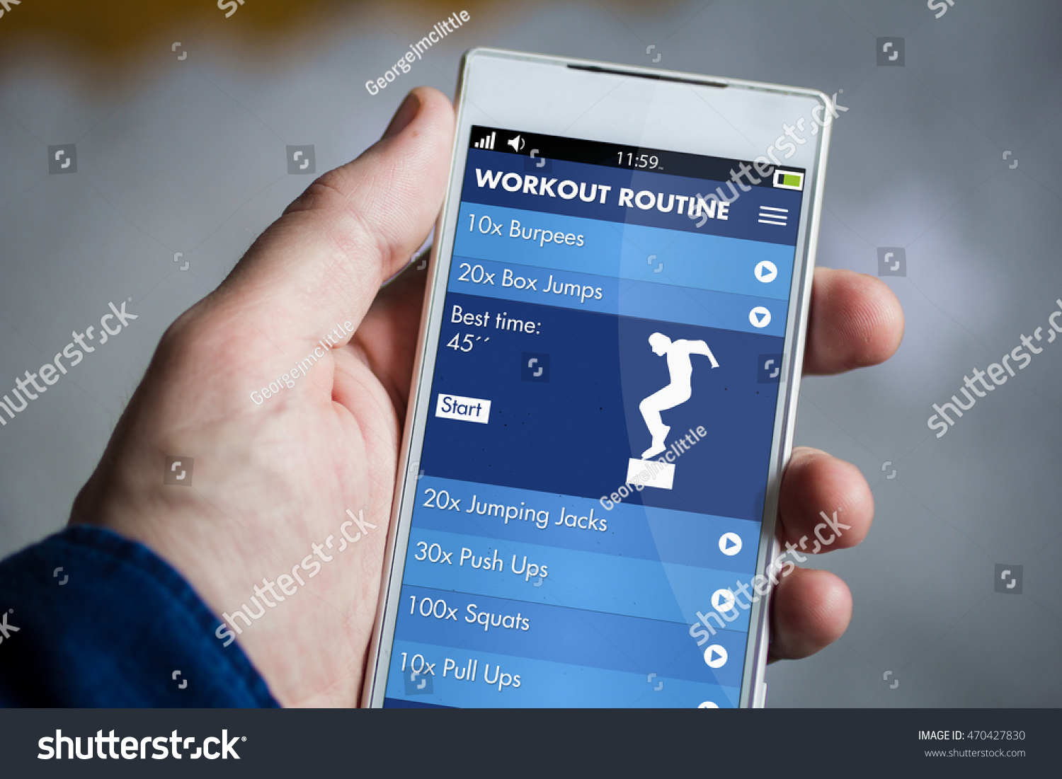 man hand holding fitness app smartphone. All screen graphics are made up. #470427830