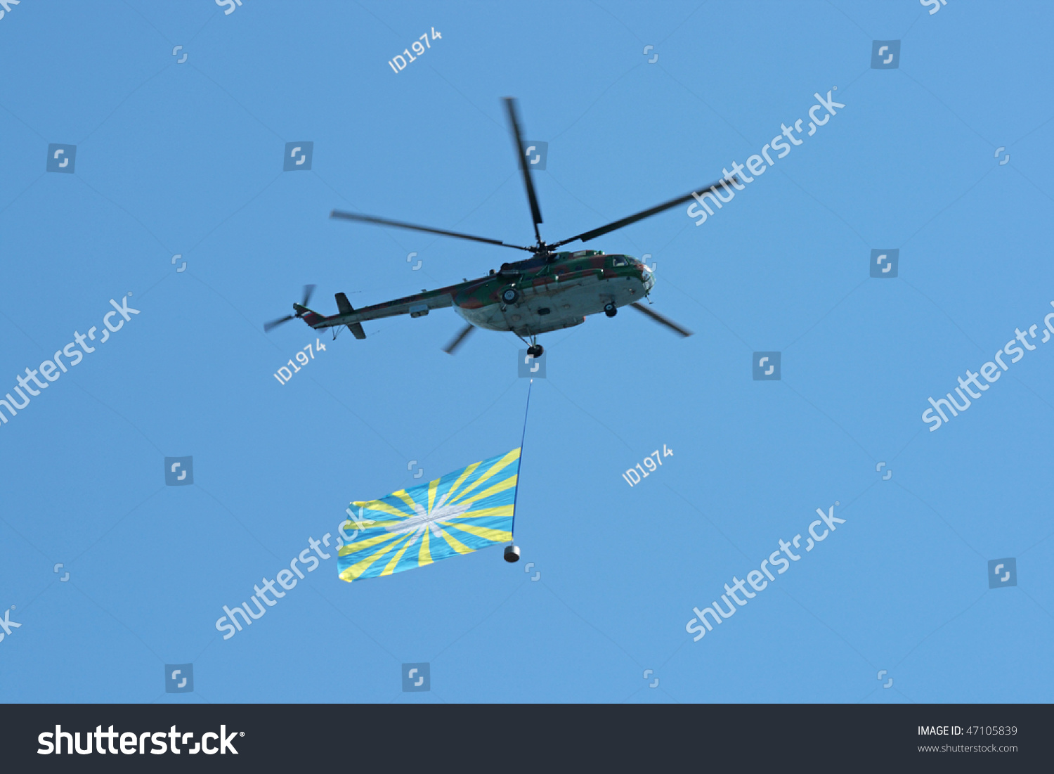 May 9: The Helicopter With A Flag Against