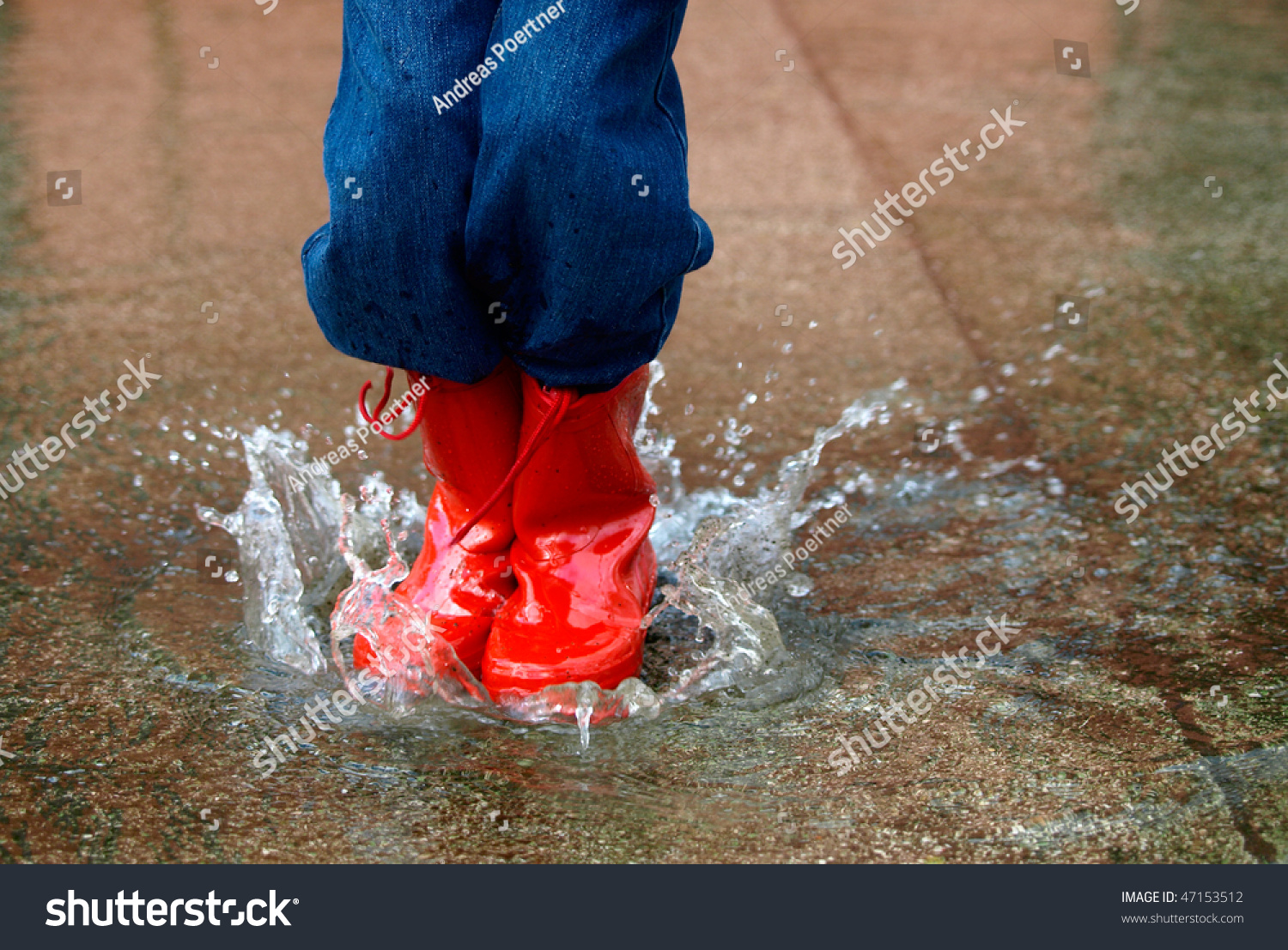 Child Rain Boots Jumps Into Puddle Stock Photo 47153512 - Shutterstock