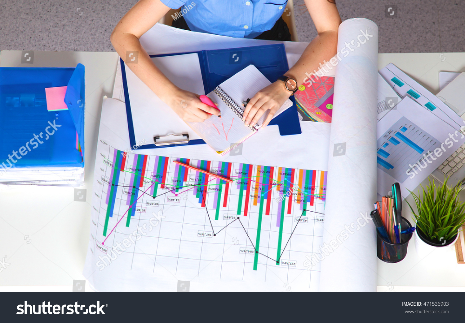 young graphic designer working on laptop stock photo 471536903 shutterstock. Black Bedroom Furniture Sets. Home Design Ideas