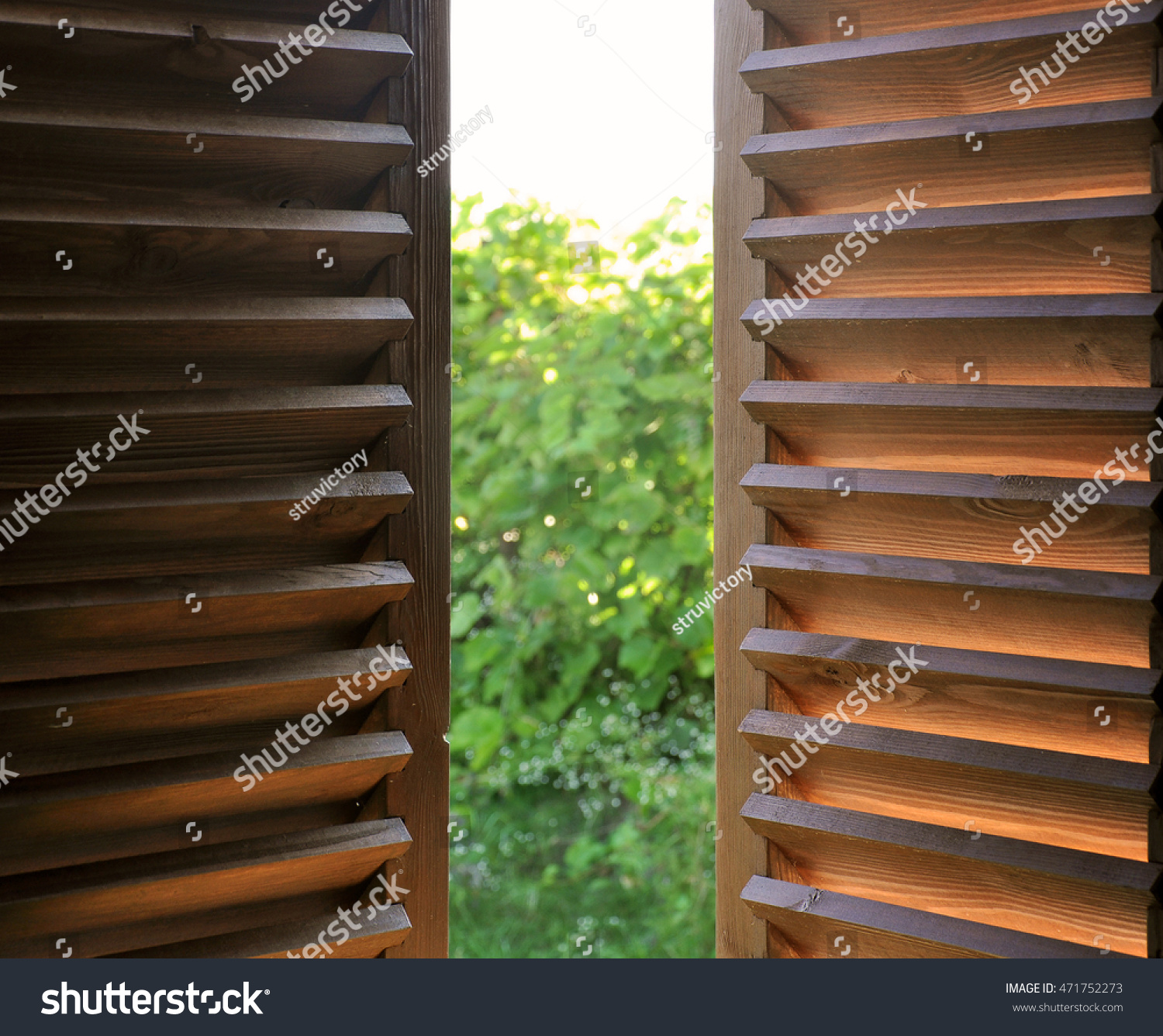 Wood Shutters Closed : Semiopen dark wooden shutters closeup view stock photo