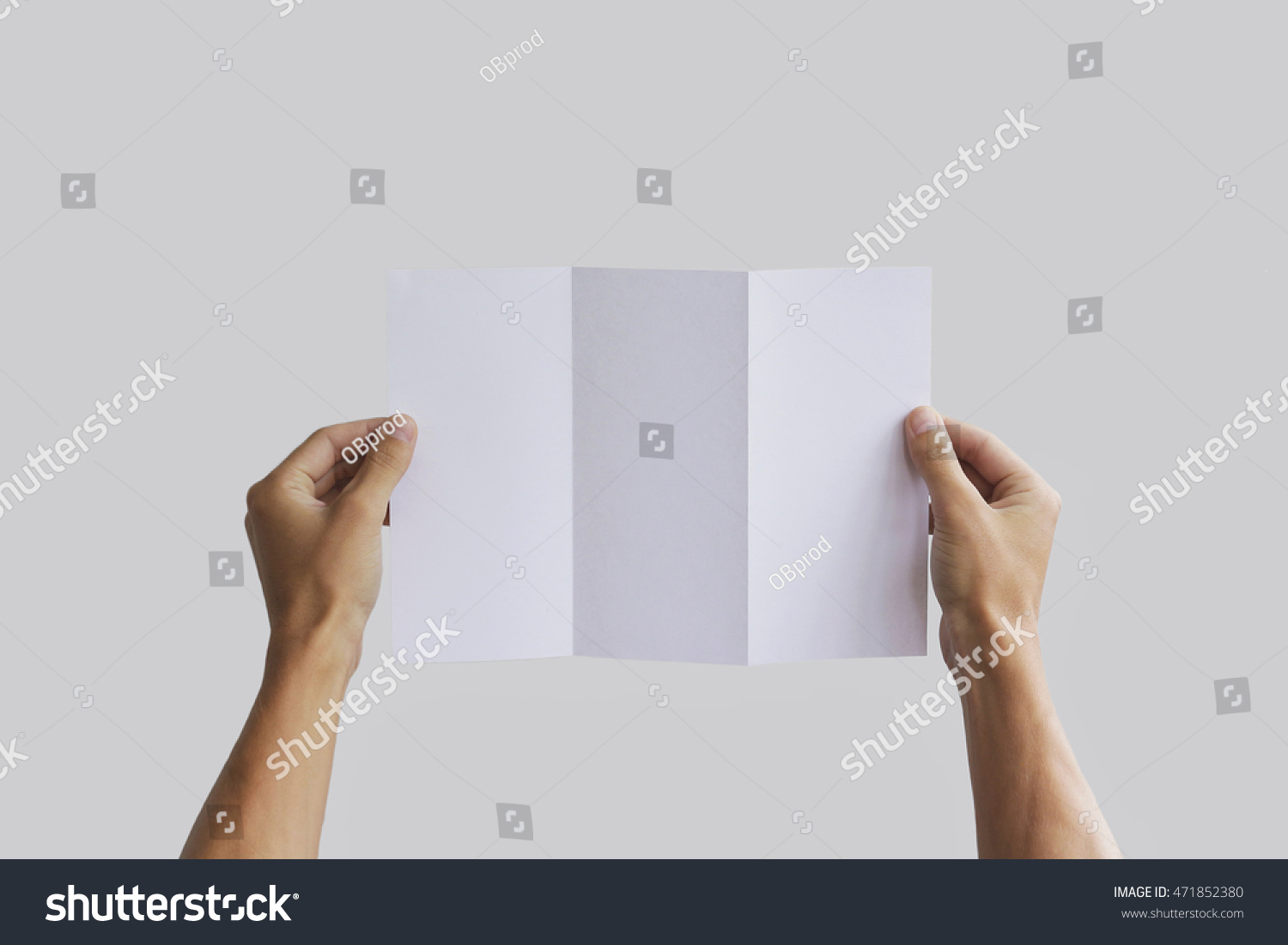 royalty free hand holding blank brochure booklet in 471852380