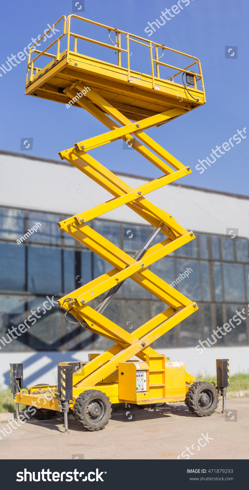 Construction Boom Lift Hydraulic : Mobile aerial work platform yellow scissor stock photo