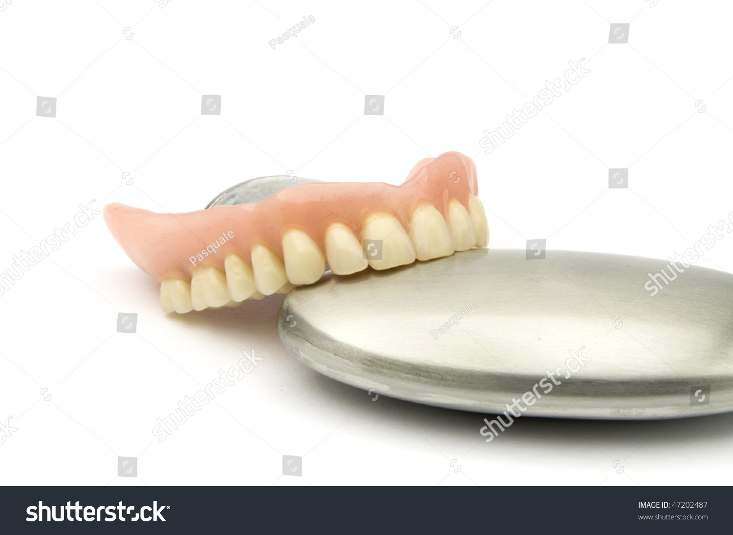 dental removable prothesis A removable dental bridge is a partial denture that you take out to clean every day, but usually not until after an adjustment period.