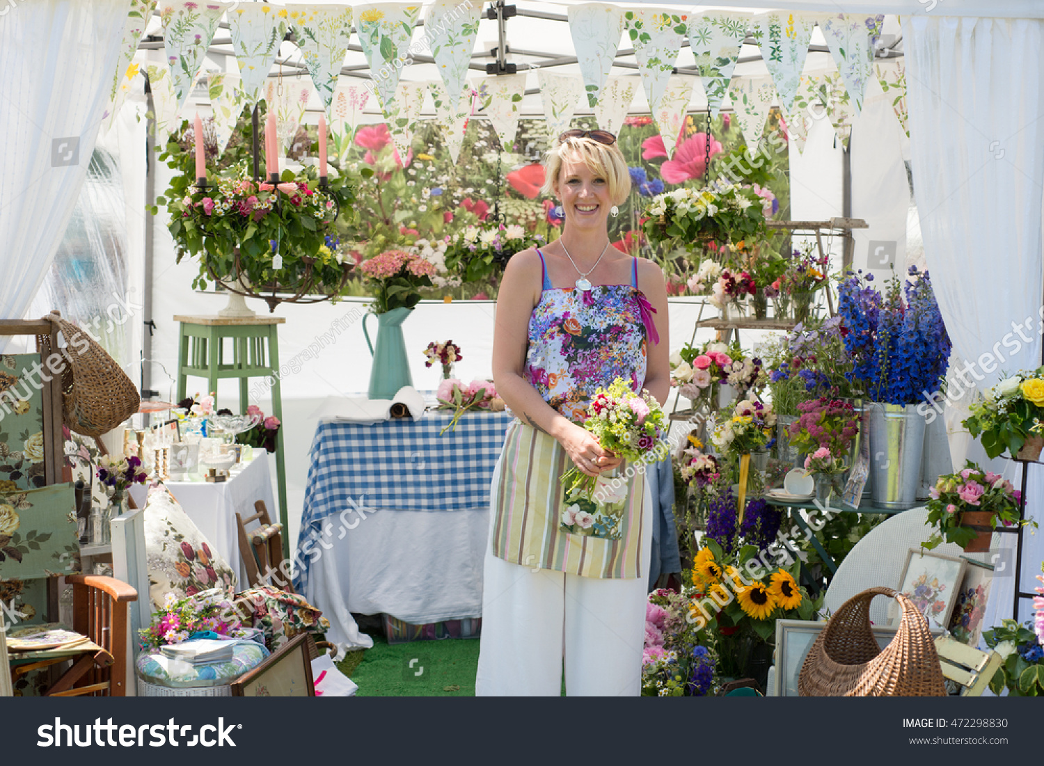 Pretty Smiling Female Florist Holding Bunch Stock Photo Download