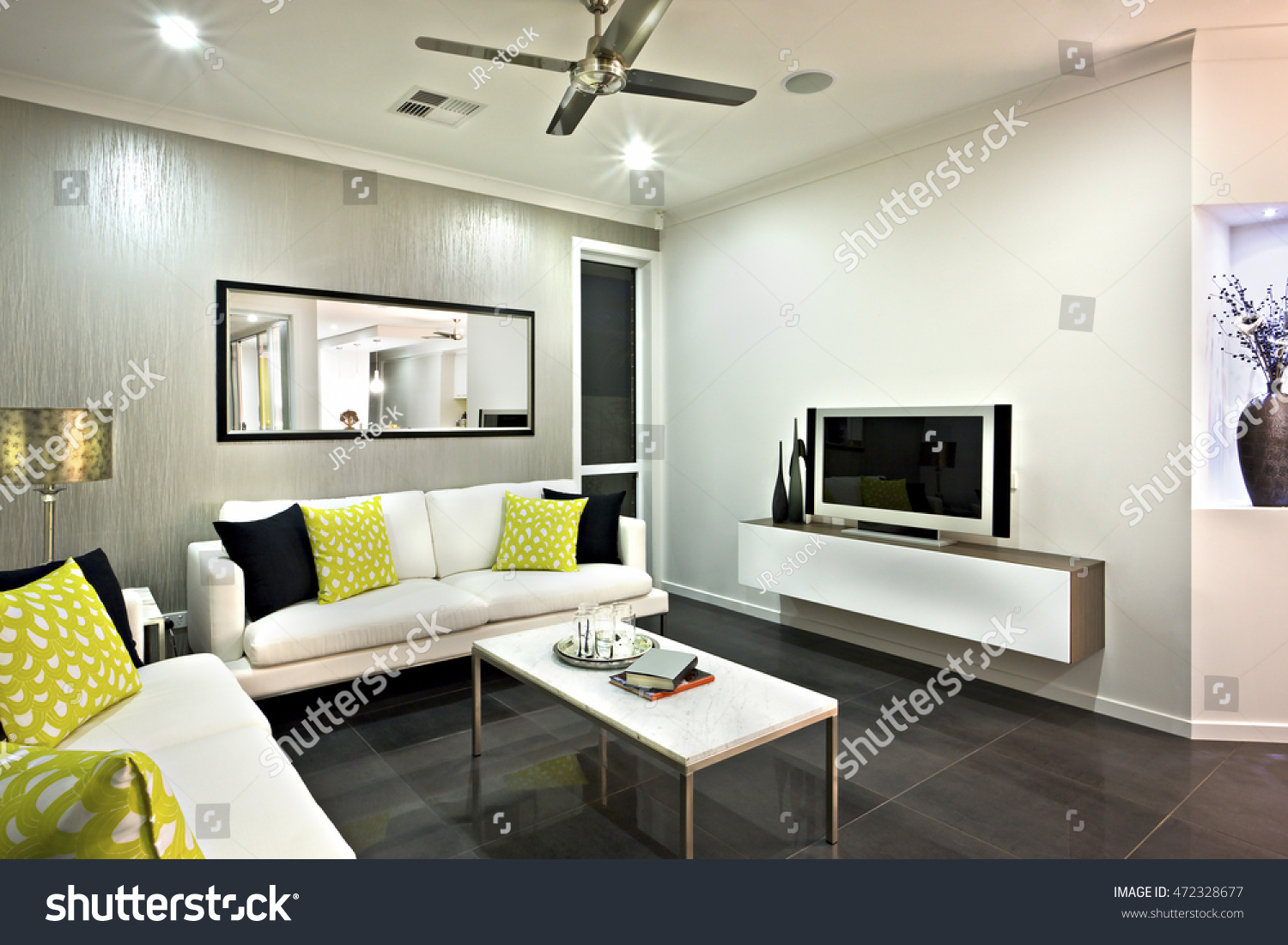 area mirror tables for living room. Living room area close up with a mirror and television under the fan on  ceiling Room Area Close Mirror Television Stock Photo 472328677