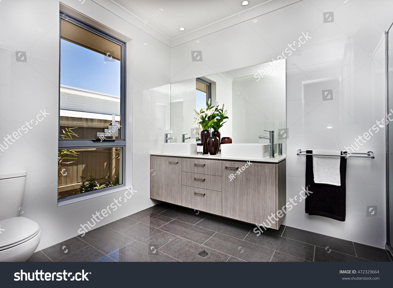 Luxury washroom window beside bowl giving stock photo for Washroom photo