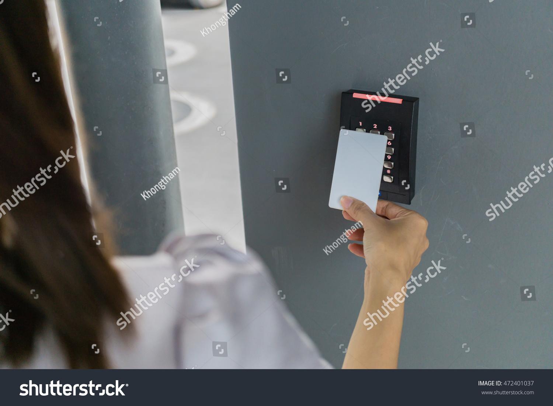 Door access control hand inserting key stock photo for Door unlock service