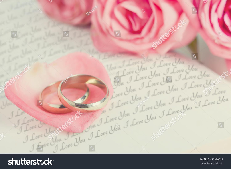 Golden Rings On Pink Rose Petal Stock Photo (Edit Now) 472989004 ...