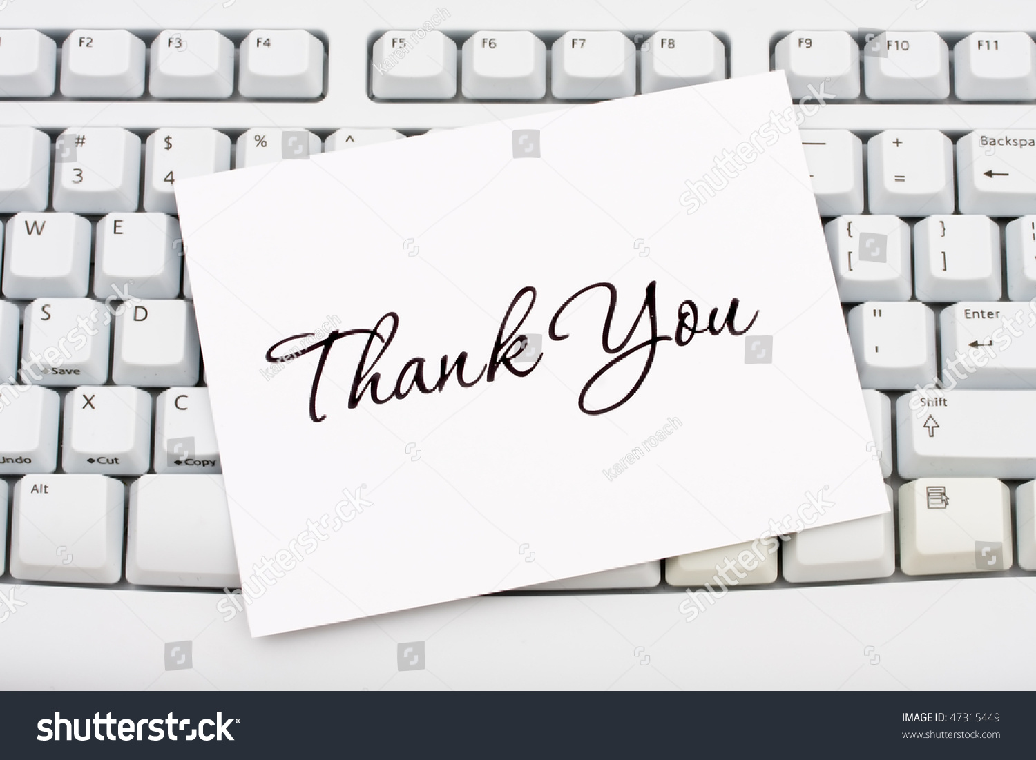 a thank you card sitting on a computer keyboard online thank you