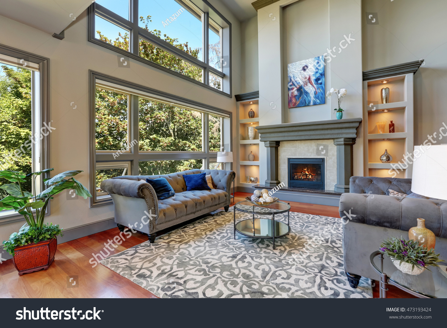 Grey interior high vaulted ceiling family stock photo for Luxury home windows
