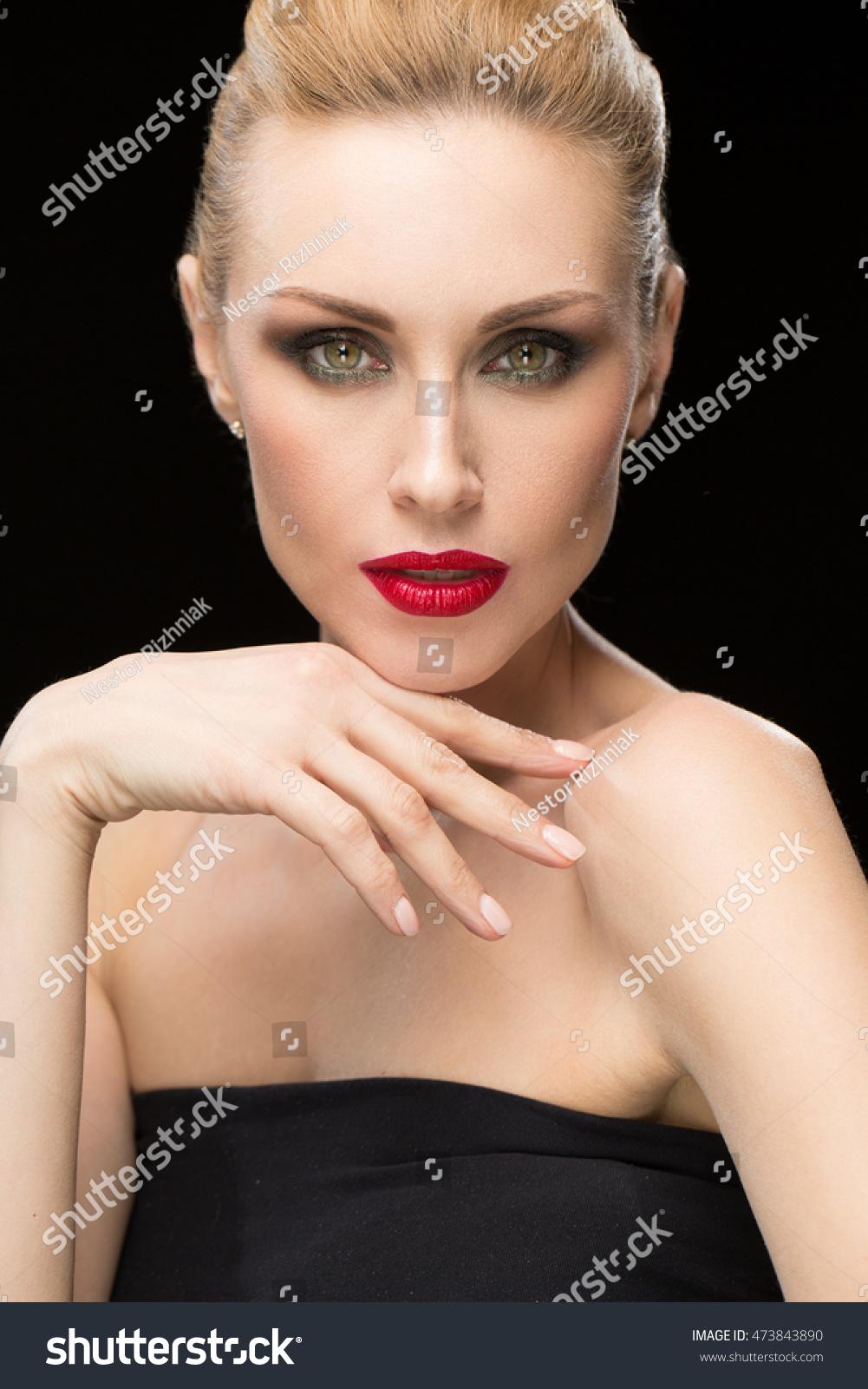 Vertical portrait of a gorgeous beautiful mature blonde woman wearing  evening makeup