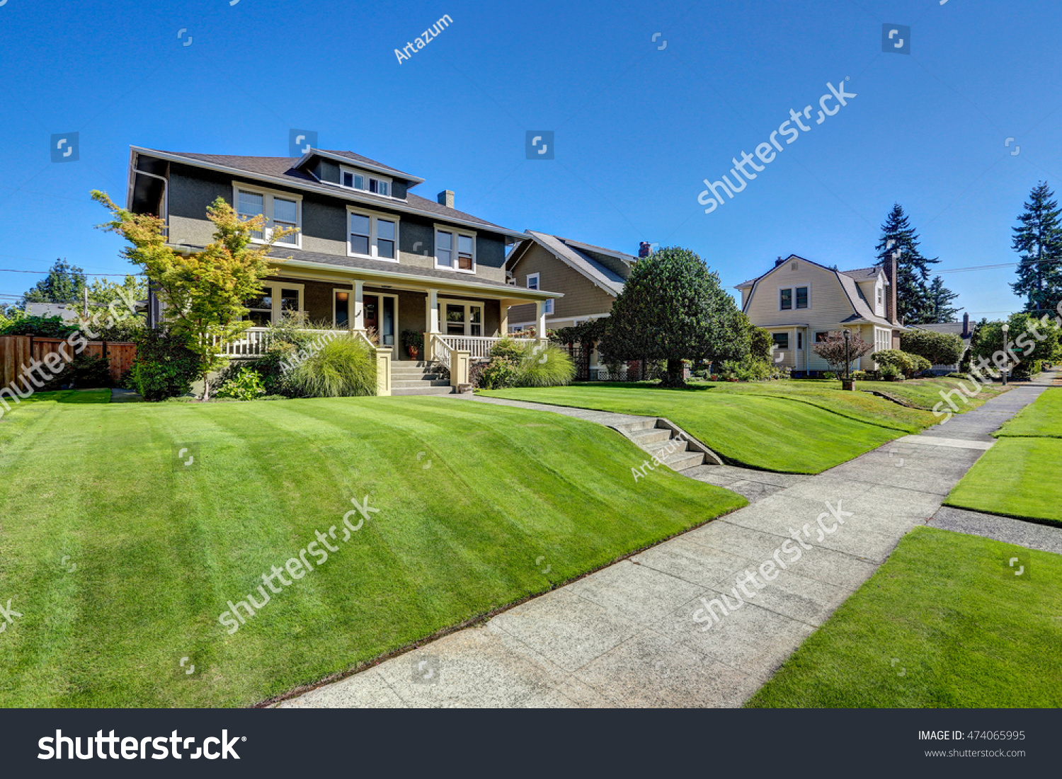 Wonderful American Craftsman Style Home - stock-photo-nice-curb-appeal-of-american-craftsman-style-house-column-porch-view-and-freshly-mowed-garden-lawn-474065995  2018_615347.jpg